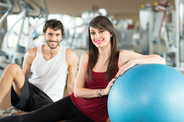 Smiling couple in a gym