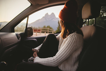 Woman in car looking out window