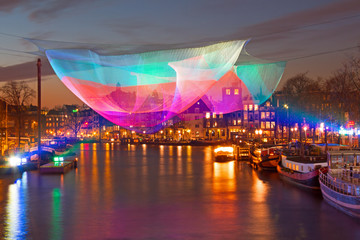 Foto op Plexiglas Amsterdam Amsterdam light festival on the river Amstel in Amsterdam Netherlands