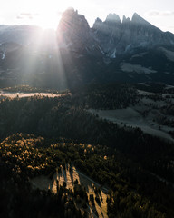 Sunrise in a mountain valley with forest in South Tyrol, Italy