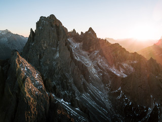Aerial of the famous dolomites Tre Cime area in Italy during sunset