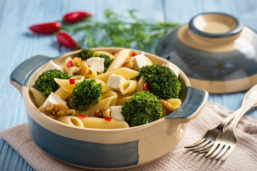 Pasta penne with broccoli, feta cheese and pepper.