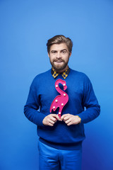 Man with artificial flamingo at studio shot