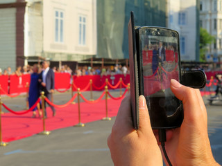 Red carpet entrance with golden stanchions and ropes. Celebrity nominees to premiere. Stars on the festive awarding of prizes awards