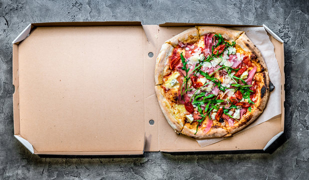 pizza with jamon in a box