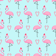 Flamingo in xmas hat with candy cane heart seamless pattern. Exotic New Year art background. Design for fabric, wallpaper, textile and decor.