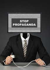 man with tv head, stop mass media propaganda concept
