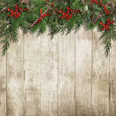 Christmas background with border of candy cane, firtree, holly