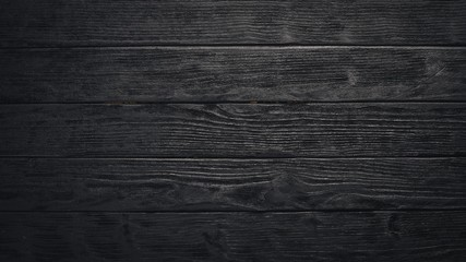 Wooden dark texture background. Top view. Free space.