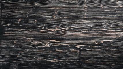 Wooden dark texture background. Top view. Free space.