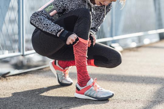 Sportswoman Holding Her Sock