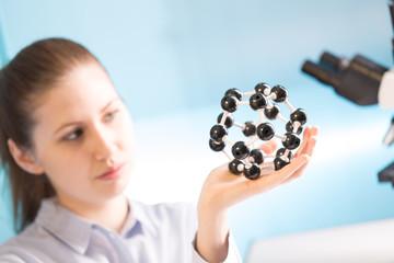 scientist woman holding molecule model