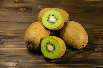 Kiwi fruits on wooden table