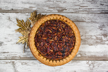 whole pecan pie in festive setting top view