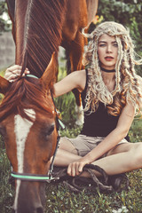 Beautiful young girl with brown horse