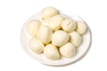 Small mozzarella balls on white plate