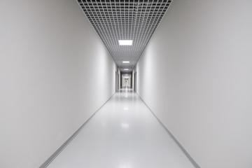 Long white empty corridor interior