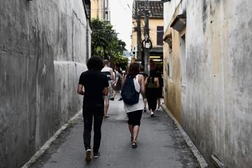 Tourists visit Hoi An ancient town