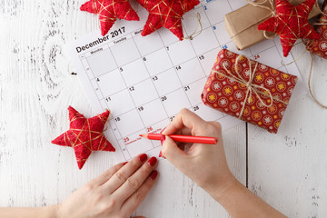 Mark the Date calendar for Christmas, December 25, with festive decorations