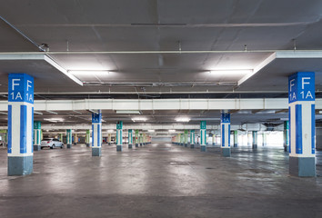 Empty parking garage underground interior in apartment or in supermarket.