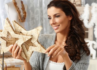 Attractive woman holding stars