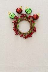 Jingle bells and small wreath on white background.