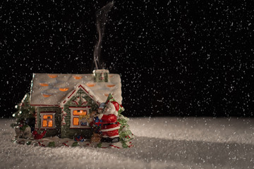 Christmas scene with Santa and snow on a black background.