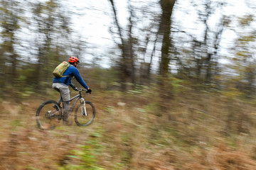 Mountain biker riding trails outside.