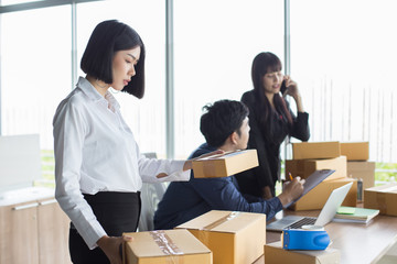 Young Asian Woman holding box and working at office, Young Owner Woman Start up for Business Online, SME, Delivery Project, Woman with Online Business or SME Concept.