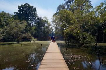 Wooden bridge to Prasat Neak Pean temple