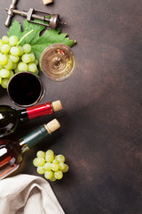Wine bottles and grapes