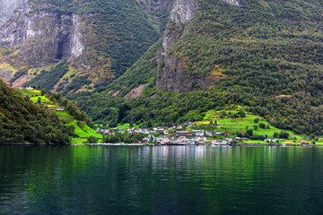 Reflection of small town in norwegian fiord, Norway