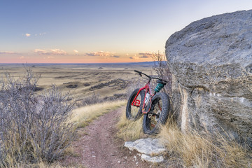 Dusk over prairie with fat bike