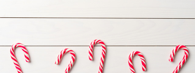 Candy cane on an old white wooden table