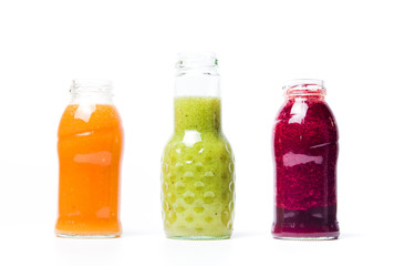 Colorful smoothies with fruits isolated