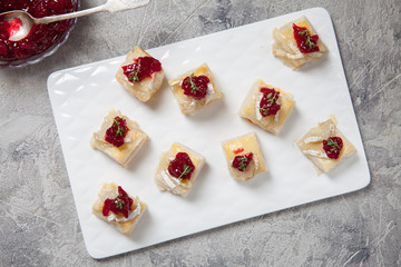 Holiday appetizers with cranberry, brie and thyme
