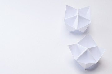 back of origami fortune tellers on white background