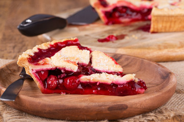 Slice of Cherry Pie on a Wooden Plate