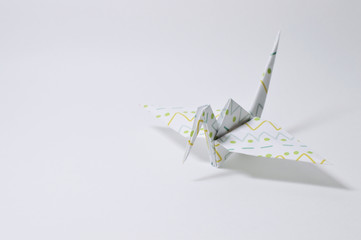 colorful origami crane on white background