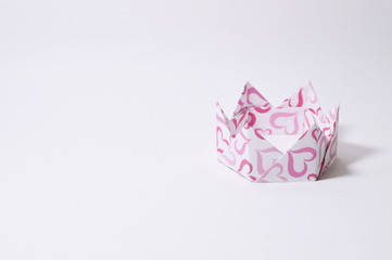 colorful origami crown on white background