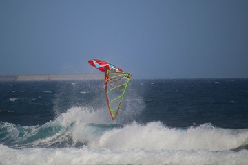 Windsurfer  upside down in the air