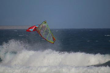 Windsurfer jumping a back loop