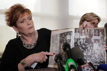 Accuser Beverly Young Nelson points to a photograph of herself in her high school yearbook after making a statement claiming that Alabama senate candidate Roy Moore sexually harassed her when she was 16, in New York