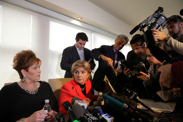 Members of the media photograph a yearbook held by Attorney Gloria Allred as she sits next to accuser Beverly Young Nelson, after making a statement claiming that Alabama senate candidate Roy Moore sexually harassed her when she was 16, in New York