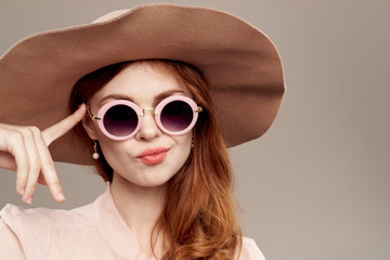 woman in glasses and hat portrait