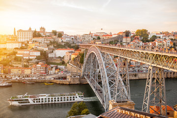 Panoramic landscape view on the old town with Douro river and famous iron bridge in Porto city during the sunset in Portugal