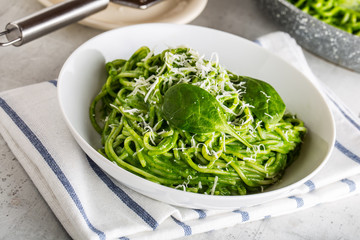 Spaghetti. Green spaghetti with spinach and parmesan. Italian and mediterranean cuisine