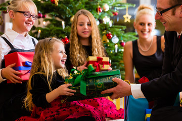 Parents and children with presents on Christmas day