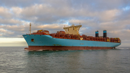 Giant container ship sideview