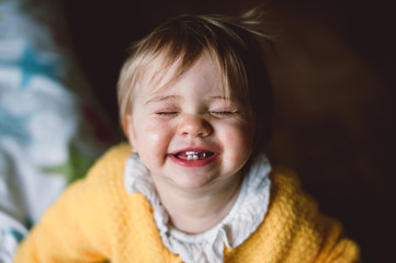 baby smiling with closed eyes